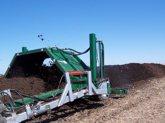Kevom Roche turns the compost once a week in the windrow