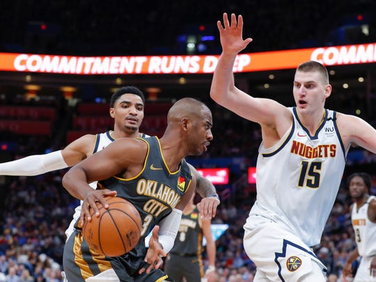 Feb 21, 2020; Oklahoma City, Oklahoma, USA; Oklahoma City Thunder guard Chris Paul (3) drives to the basket against Denver Nuggets center Nikola Jokic (15) during the second half at Chesapeake Energy Arena. Oklahoma City won 113-101. Mandatory Credit: Alonzo Adams-USA TODAY Sports