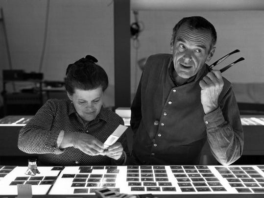 1. The World of Charles and Ray Eames. Charles and Ray Eames selecting slide