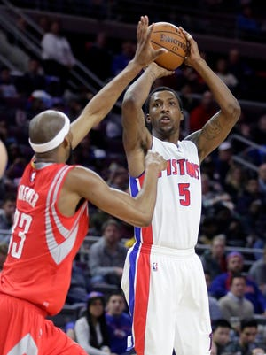 Detroit Pistons' Kentavious Caldwell-Pope takes a shot against Houston Rockets' Corey Brewer during the second half Saturday. Caldwell-Pope scored 28 points in the Pistons 114-101 win over the Rockets.