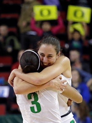 Oregon's Maite Cazorla is embraced by Justine Hall (3) after the team defeated UCLA 65-62 in an NCAA college basketball game in the semifinals of the Pac-12 women's tournament, Saturday, March 3, 2018, in Seattle.