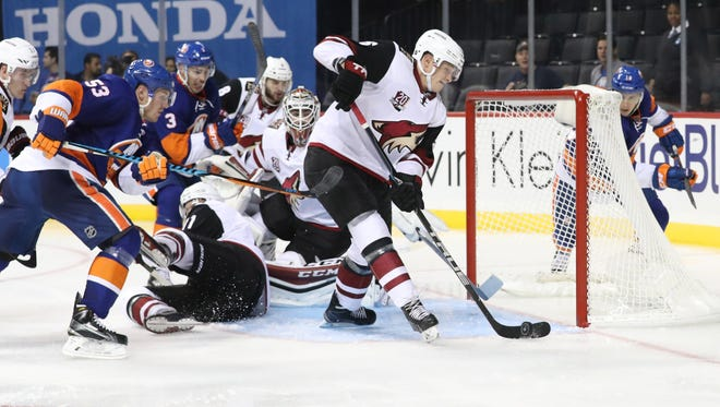 Oct 21, 2016; Brooklyn, NY, USA;  Coyotes defenseman Jakob Chychrun (6) clears a puck from an empty net during the second period against the Islanders at Barclays Center.