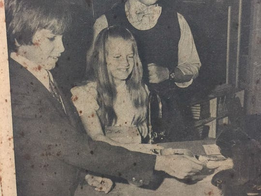 Bruce Wachter, completing his 45th year at St. Edward's School, was featured on the front page of the Press Journal Feb. 10, 1974, his first year at the school. Photographer Mary Beth Herzog captured this image of Wachter, a science teacher, watching as sixth-graders Rainer Zeck and Nancy Neill feed Wachter's monkey, Sam.