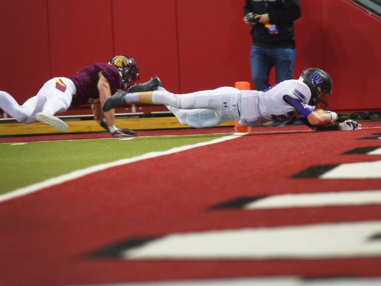 Dakota Valley's Jack McCabe scores a touchdown during the game against Madison during the first half Saturday, Nov. 11, at the DakotaDome in Vermillion.