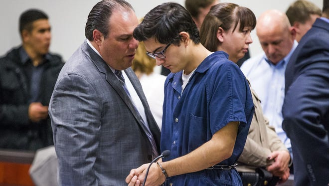 Steven Jones, 19, who is charged with first-degree murder and aggravated assault in the death of one NAU student and the wounding of three others on the Flagstaff campus on October 9, 2015, listens to his defense attorney, Burges McCowan, left,  in Coconino County Superior Court in Flagstaff, Friday, February 19, 2016.