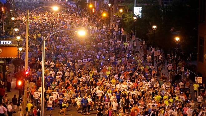 Storm the Bastille - shown in 2015 - is an evening run through downtown Milwaukee. This year's event is July 12.