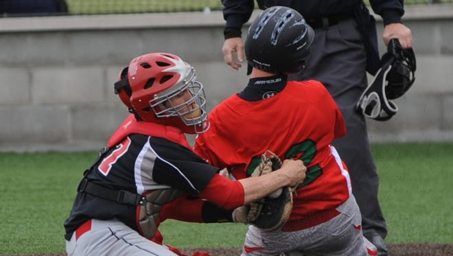 Richmond catcher James Hall, left, tags out Anderson's Chandler Bucci on a play at the plate during Monday's game at Sadler Stadium.