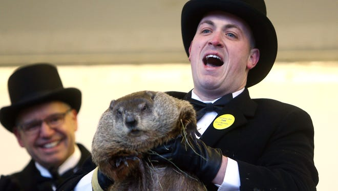 Groundhog Wrangler John McNamara of Milltown lifts up Milltown Mel as he makes his annual prediction on Groundhog Day at the American Legion in Milltown, NJ. Milltown Mel did not see his shadow this morning, according to folklore,  the spring season will arrive early. The event is in its tenth year. February 2, 2018. Milltown, NJ.