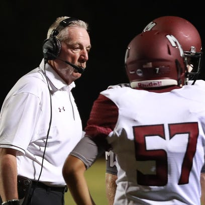 Mt. Whitney football coach Marty Martin speaks with
