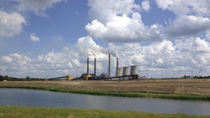 This June 3, 2014, file photo shows the Paradise Fossil Plant in Drakesboro Ky. The Tennessee Valley Authority voted Thursday to retire the remaining coal-fired unit at its Paradise Fossil Plant by December 2020.