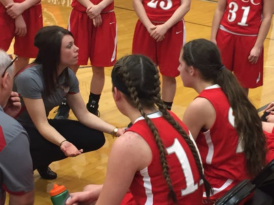 St. Joseph Central Catholic girls basketball coach Mallory Holliday speaks to her team during a timeout in SJCC's district tournament game against Carey Thursday night.