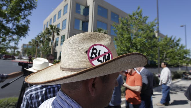 Ammon Bundy, son of Nevada rancher Cliven Bundy, stands outside Metropolitan Police Department headquarters on May 2 in Las Vegas. Bundy was in town to file a criminal complaint against the U.s. Bureau of Land Management. The previous month, federal agents launched a cattle roundup on the Bundy ranch after they refused a court order to remove their cattle from public land and pay a grazing fee.  Backers of a bill to put more federal land in state hands in Nevada plan to change the title of their proposed legislation and remove language that reminds people of the Bundy controversy.