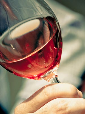 A rose wine has a pink color because it includes some of the color from grape skins.