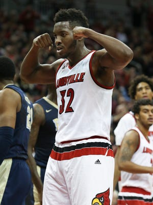 U of L's Chinanu Onuaku, #32, flexes after scoring and earning free throw against Pitt during their game at the KFC Yum! Center.Jan. 14, 2015
