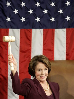 Pelosi wields the speaker's gavel after being elected as the first female House speaker during a swearing-in ceremony for the 110th Congress on Jan. 4, 2007.
