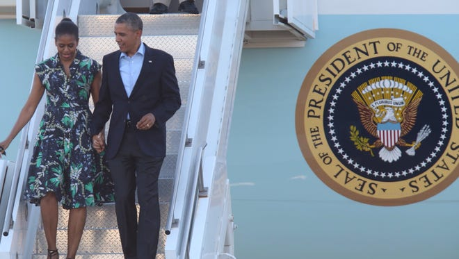 President Barack Obama and First Lady Michelle Obama exit Air Force One after landing at Palm Springs International Airport in 2014.