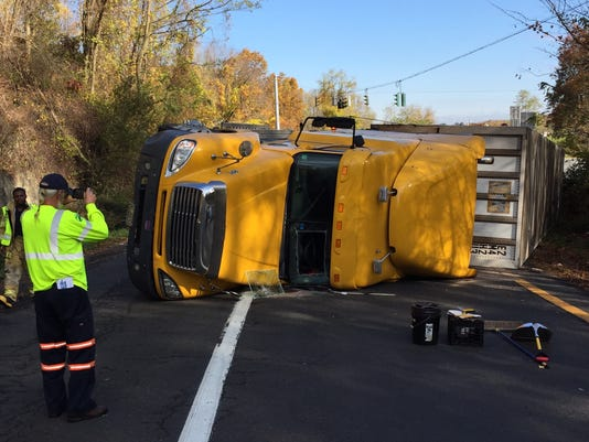 Tractor-trailer flips on -684 Exit 4 entrance