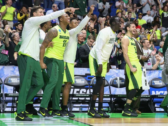 The Baylor bench celebrates during the second half