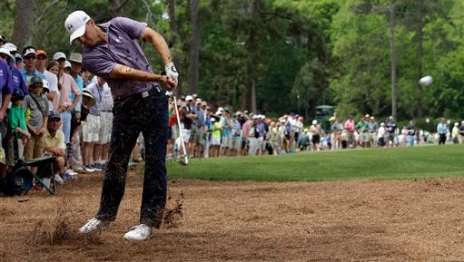 Jordan Spieth hits out of the rough on the 14th hole during the second round of the Masters golf tournament Friday in Augusta, Georgia.