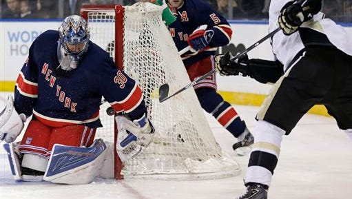 Pittsburgh Penguins right wing Patric Hornqvist, right, scores a goal past New York Rangers goalie Henrik Lundqvist, left, in the first period of an NHL hockey game, Sunday, March 13, 2016, in New York.