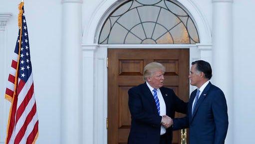 President-elect Donald Trump and Mitt Romney shake hands Nov. 19 as Romney leaves Trump National Golf Club Bedminster in Bedminster, N.J.,