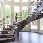 Lake home built around gorgeous spiral staircase
