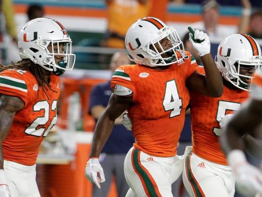 Miami defensive back Jaquan Johnson (4) celebrates