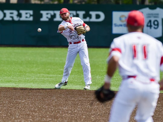 Stefan Trosclair throws out the runner as the Cajuns