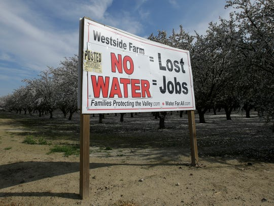 A sign calling attention to the loss of jobs blamed on the lack of water is displayed near Lemoore on Feb. 25, 2016.
