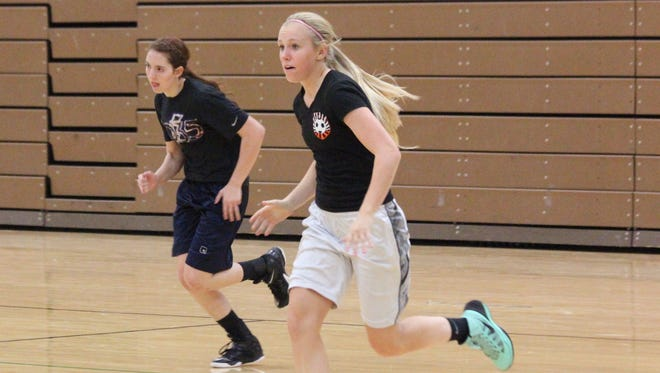 Lady Bulldogs, from left, Briana Todd and Spencer Green participate in a drill at a recent practice.