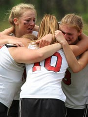 Members of the Lakeland girls' lacrosse team celebrate and rejoice after defeating two-time defending champions Wayne Hills in last May's Passaic County Tournament title game.