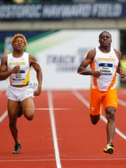 Tennessee's Christian Coleman, right, cruises across