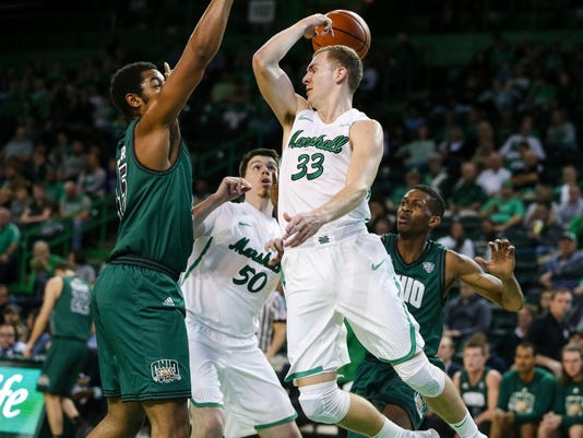 Marshall's Jon Elmore (33) makes a behind the back pass to teammate Milan Mijovic (50) during an NCAA college basketball game against Ohio, Saturday, Dec. 16, 2017 in Huntington, W.Va. (Sholten Singer/The Herald-Dispatch via AP)