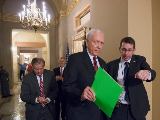 Members of the Senate Judiciary Committee, Sen. Orrin Hatch, R-Utah, center, followed by Sen. Lindsey Graham, R-South Carolina, left, and Sen. Thom Tillis, R-North Carolina, rear, leave a closed meeting in the office of Senate Majority Leader Mitch McConnell of Kentucky, on Capitol Hill Tuesday.