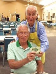 Monday Night Bingo's big winner was Al Splittberger, a visitor from St. Charles, Illinois. Committee member Dr. Herb Kern hands him his winnings.