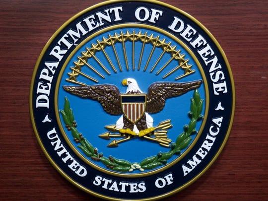 The US Department of Defense (DOD) logo is seen on the lecturn in the media briefing room at the  Pentagon.