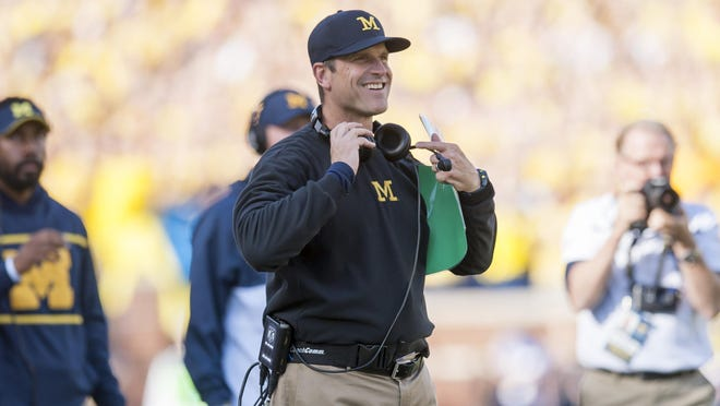 Jim Harbaugh will have his team's spring game during the evening April 1.