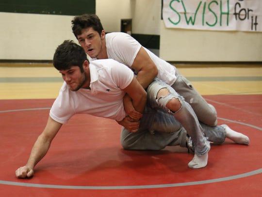 Leonardo Pan attends the Greenbrier High School wrestling camp.