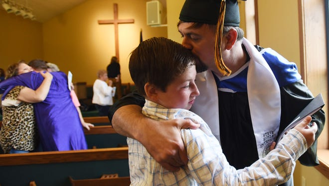 Robert Berry hugs his son, Conner Berry, moments after the graduation ceremony for the Steve Hoyle Intensive Substance Abuse program.