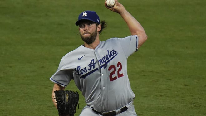 Los Angeles Dodgers starting pitcher Clayton Kershaw throws against the Los Angeles Angels during the fourth inning of a baseball game, Friday, Aug. 14, 2020, in Anaheim, Calif.