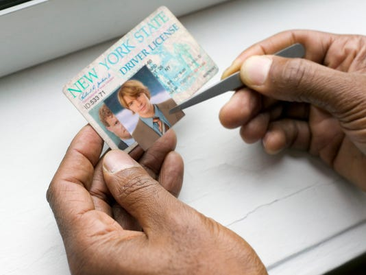 Hands making fake ID