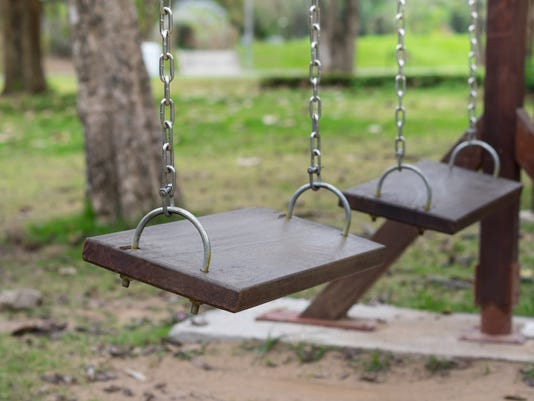 Wooden old swings in playground