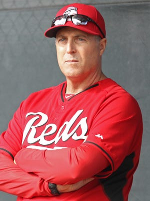 Reds manager Bryan Price observes a bullpen session at spring training, Sunday, Feb. 22, 2015, in Goodyear, Arizona.
