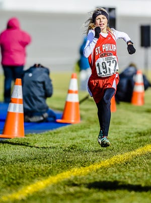 St. Philip's Ava Strenge, here winning the 2014 MHSAA Division 4 Cross Country State Championship, finished first at the Rust Buster Invite on Tuesday.