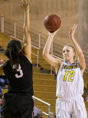 Delaware's Hannah Jardine (No. 12) puts up a shot as Northeastern's Loren Lassiter defends in the first half of Delaware's 59-52 win over Northeastern at the Bob Carpenter Center in Newark on Sunday afternoon.