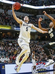 Butler Bulldogs guard Paul Jorgensen (5) gets an easy layup after a steal against the Purdue Boilermakers during the Crossroads Classic at Bankers Life Fieldhouse in Indianapolis on Saturday, Dec. 16, 2017.