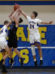 Ankeny Christian senior Chad Elrod tries to get a shot off against Martensdale-St. Marys in a Jan. 3 game in Martensdale.