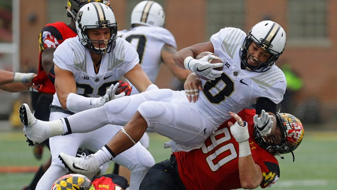 Purdue running back Markell Jones is upended by Maryland defensive lineman Roman Braglio (90) as he rushes the ball in the first half of the Terrapins' 50-7 win on Oct. 1, 2016.