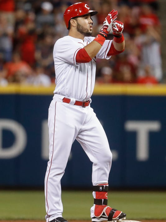 Cincinnati Reds' Eugenio Suarez reacts after hitting an RBI double off Atlanta Braves relief pitcher Jim Johnson during the ninth inning of a baseball game, Friday, June 2, 2017, in Cincinnati. The Reds won 3-2. (AP Photo/John Minchillo)