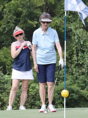 Vicki Hatcher, left, and June Henderson line up their putt on the sixth green during the Tee It Up for Kitties & Kanines, 2-Lady Scramble, Tuesday, Sept. 8, at Vache Grasse Country Club in Greenwood. Seventeen teams played in the benefit golf tournament that included a practice round, continental breakfast and lunch with cash prizes to the top teams.